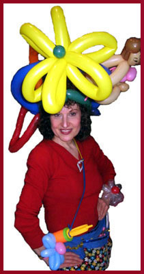 Balloon maker Daisy Doodle twists balloon hats for adult parties as well as for kids entertainment in NYC, as you can see by her elaborate balloon hat and balloon flower bracelets.