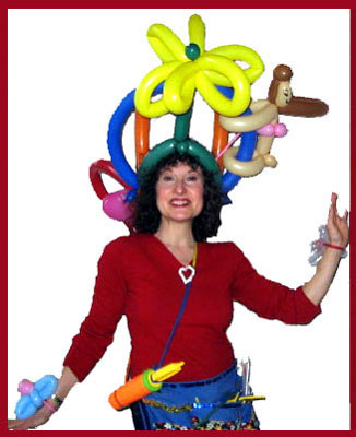 Wow!  What an amazing balloon hat balloonist Daisy Doodle has twisted for herself for her gig at a restaurant in Manhattan's west side, plus balloon flower bracelets.