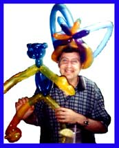 Daisy Doodle twists animal balloons for parties, including birthday parties for adults, with the birthday man holding his animal balloon and wearing his balloon hat.