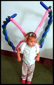 This little girl is wearing animal balloon twisted butterfly wings at company party.  Isn't she cute?