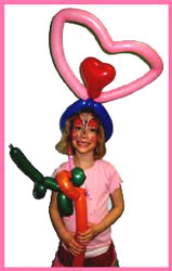 A special balloon hat and animal balloon twisting for the birthday girl at her party by balloon artist Daisy Doodle