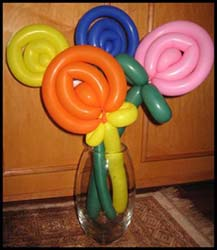 Balloon artist Daisy Doodle twisted balloons into lollipop shapes for a corporate party based in New Jersey