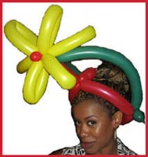 This lady looks very fashionable in her flower balloon hat twisted by balloon artist Daisy Doodle