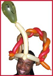 Daisy Doodle loves to twist balloon hats to entertain the men who are celebrating their birthdays