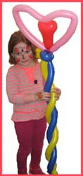 This balloon twisted heart flower is bigger than the child is at a party in Connecticut!