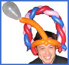 This gentleman proudly sports his  twisted balloon hat as he celebrates his birthday at a restaurant in New York