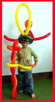 This child models his cool balloon sword, belt and balloon hat at a kids company party
