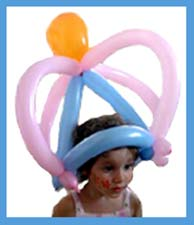 The birthday party girl wearing her special balloon crown made by balloon twister Daisy Doodle