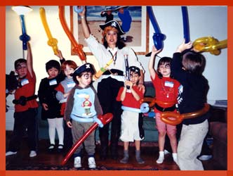 Captain Daisy Doodle twists balloon swords and sword belts for kids at a pirate party in Westchester