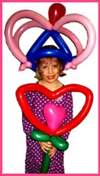 The birthday girl always gets a balloon crown and special heart flower balloon twisted especially for her at her birthday party.