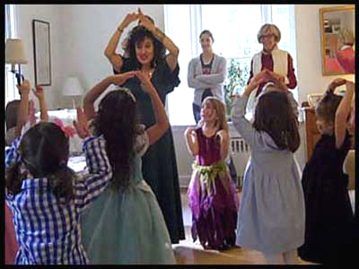Princess Daisy Doodle teaching children how to dance the YMCA