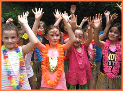 Kids learning how to hula dance at Hawaiian Luau birthday party