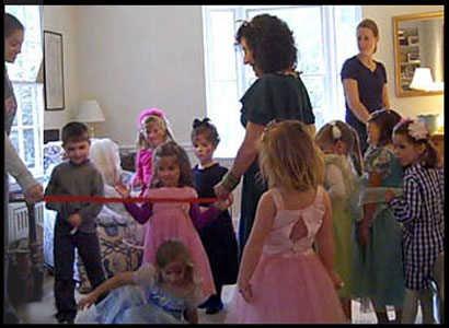 Children wait in line for the limbo dance