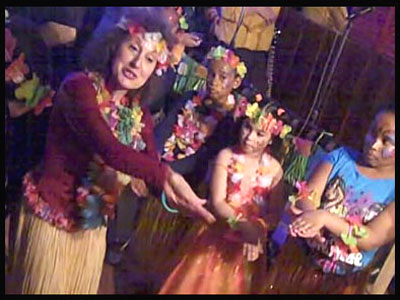 Kids learn a Hawaiian dance at hula lesson in Queens NY