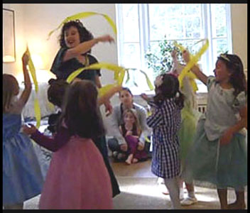Kids dance with streamer wands at princess birthday party