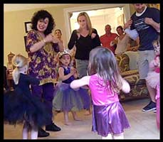 Children make chicken wing arms for the Chicken Dance at this birthday party in Long Island NY