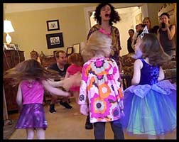Kids make their hair fly during twist birthday party dance entertainment
