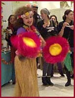 Daisy Doodles uses bright colored dramatic props in her opening number for kids hula dance entertainment