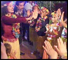 Kids learn arm movements of Hawaiian dancing in a hula lesson at this birthday party