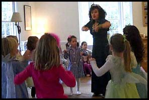 Children follow princess Daisy Doodle as they learn how to do the chicken dance at a birthday dance party in Westchester NY