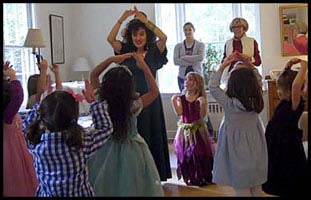 Grandma joins in to dance with the birthday girl to popular YMCA party dance entertainment