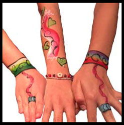 Girls get jewelry body painting on hands at birthday party nyc