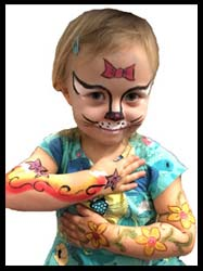 Birthday girl gets face painted as Hello Kitty and body painted with rainbow and flowers