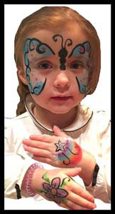 Girl gets butterfly face painting and hands body painted at birthday party in Queens NY