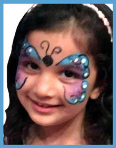 birthday girl gets face painted as  butterfly with her favorite colors