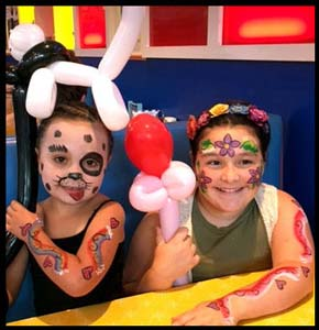 Girls got face and body painted at Big Daddys Diner in Manhattan NY