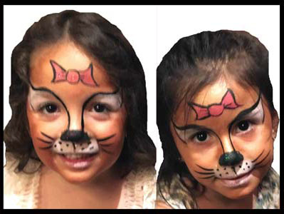 Girls get face painted as Hello Kitty at childrens birthday party in Brooklyn NY