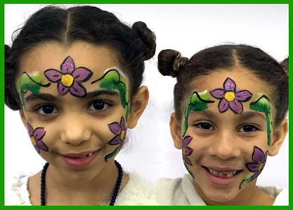 Sisters face painted with flowers at birthday party in Queens NY