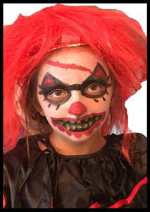 Scary evil clown Halloween face painting to  match child's costume
