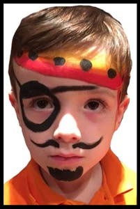 Boy face painted as pirate at restaurant Kids Night in Manhattan NY
