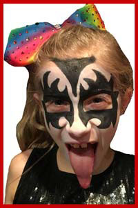 Girl in new york city got face painted as rock star Gene Simmons