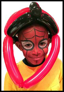 Boy wears a balloon helmut to match his spiderman face painting in Jersey City NJ