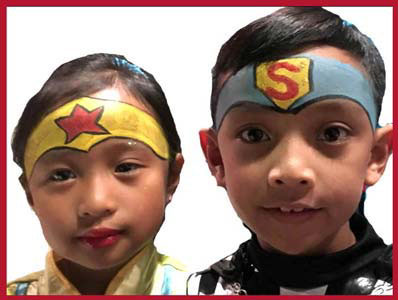 Children are face painted as super heros at kids party in Bronx NY