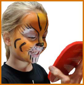 Boy admires his tiger face painting at corporate party nyc