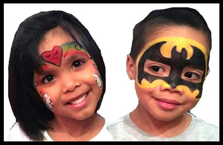 Birthday party twins smile after getting face painted by Daisy Doodle in Brooklyn NY