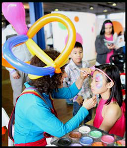 Daisy Doodle face painting child at corporate party in Manhattan NY