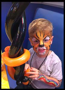 This child looks ferocious with tiger face painting plus body painting nyc