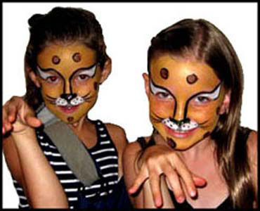 girls pose in character for cheetah face painting at childrens party in Westchester NY.