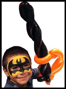 boy face painted as batman superhero with balloon sword in Manhattan NY