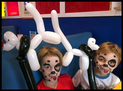 Boys are face painted as dalmations with matching twisted balloon dogs