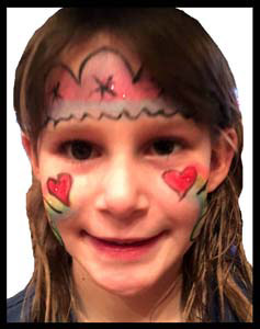 Girl is face painted with party crown and rainbow hearts in Manhattan NY