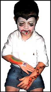 A boy wanted his face painted as a vampire, plus both arms body painted at this birthday party in Brooklyn NY