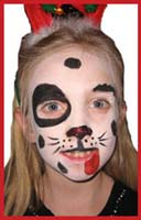 A set of antlers gives a holiday flavor to this child facepainted as a dog at corporate xmas party