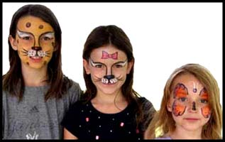 Girls at a company picnic in Westchester NY all picked different animals for their facepainting.  Now on to the games!