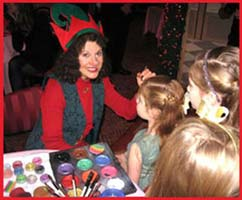 Daisy Doodle dresses up as a holiday elf to facepaint the kids at this corporate Xmas party
