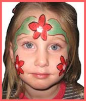 This kid's face is painted with poinsetta flowers for what Daisy Doodle calls a